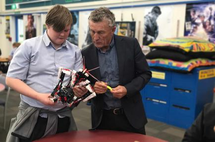 Student explains programming on Lego Mindstorm to Greymouth mayor