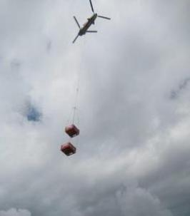 Chinook helicopter lifting two crates