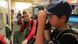 Students exploring old dial phones.