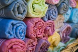 Rolls of brightly coloured fabrics