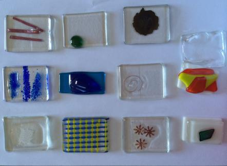 Participant's samples of layering and fusing glass