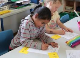 Primary students filling in worksheets