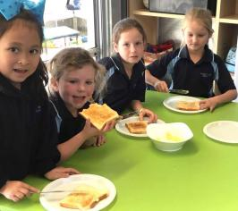 children eating toast with butter they made