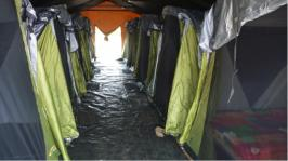 Image of accommodation tents inside larger tent