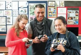 Students with digital cameras with their teacher