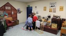 Students and teacher explore an old style room