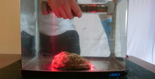 Paua measuring tool being tested in a fish tank
