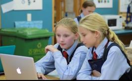 Two students planning using a computer