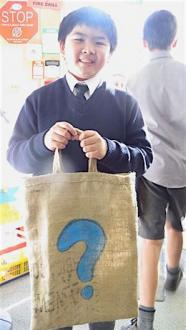 Student holding his library bag