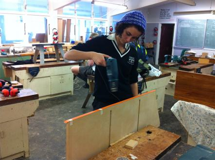 Year 13 student drilling into MDF sides.