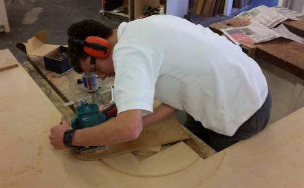 Student using saw.