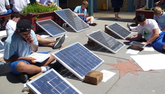 Students testing their photo voltaic water heating systems