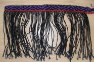 Example of student weaving with the first strip of design completed