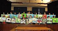 Students show their prints at assembly