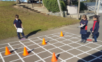 Students with an outdoor grid writing instructions for a kidbot