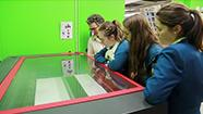 Students look at lab equipment with Fab Lab manager
