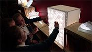Students looking at a light