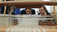 Students looking into loom.